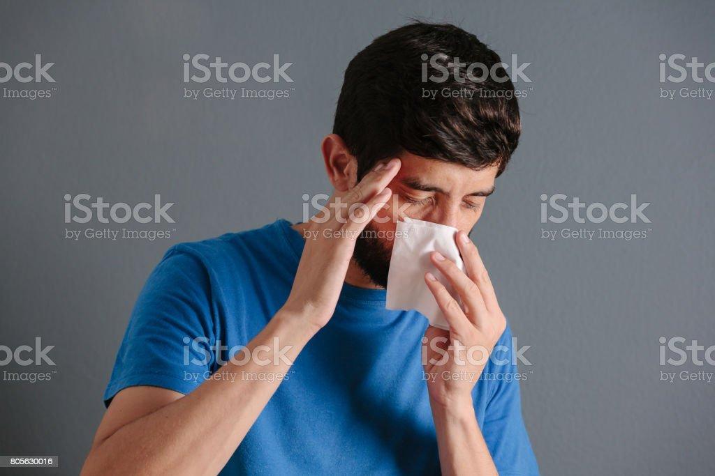 Sinus pain, sinus pressure, sinusitis. Sad man holding his nose...