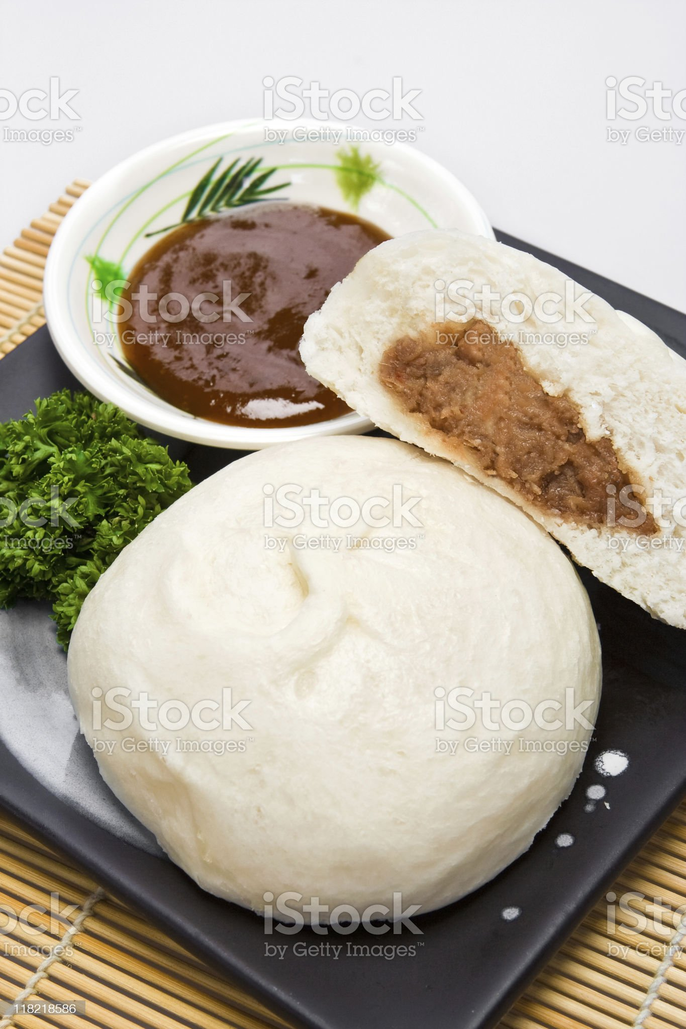 Siopao with hoisin sauce on the side royalty-free stock photo