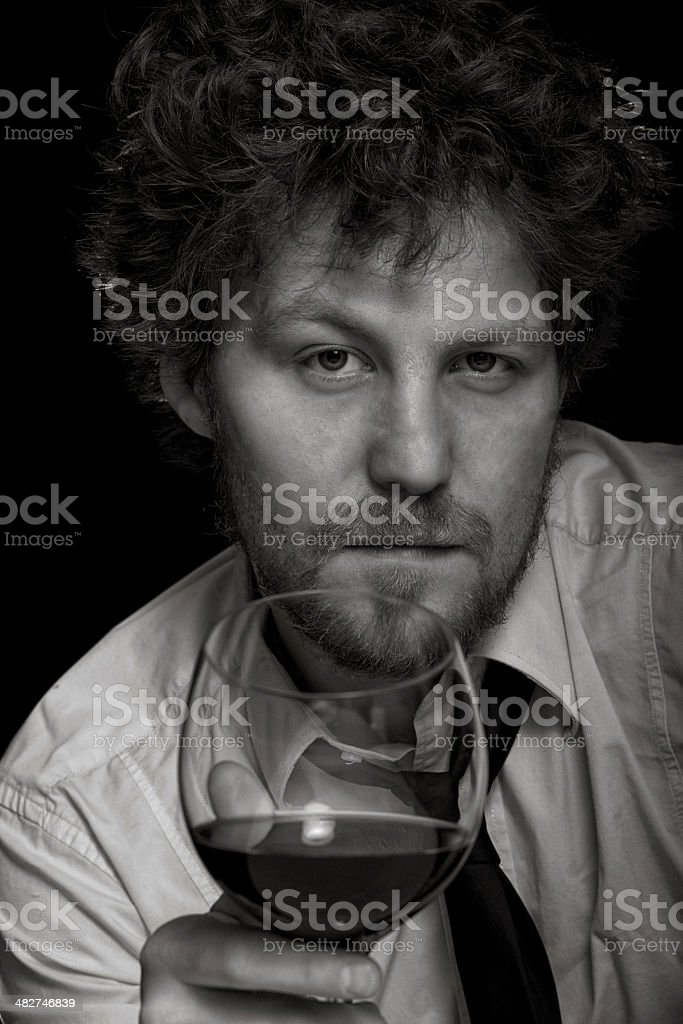 Sipping a glass of wine stock photo