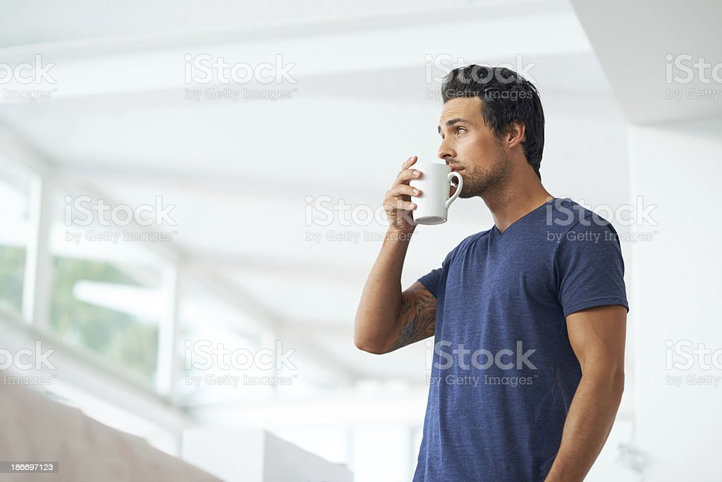 Sipping on a cup of coffee stock photo