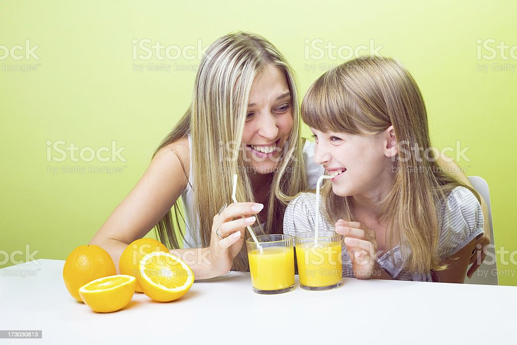 Sipping orange juice together royalty-free stock photo