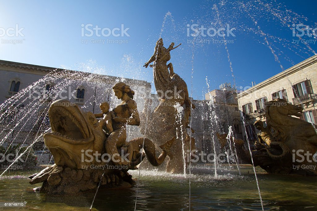 Siracusa, Sicily: Fountain of Diana Under Brilliant Blue Sky stock photo