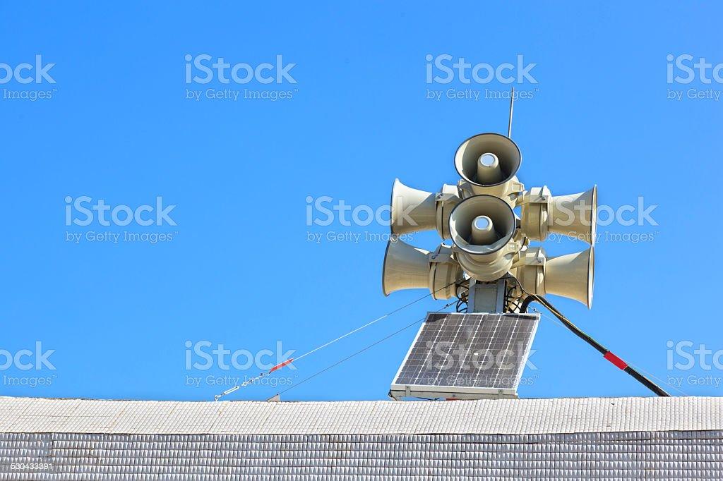Siren or megaphone and solar energy stock photo