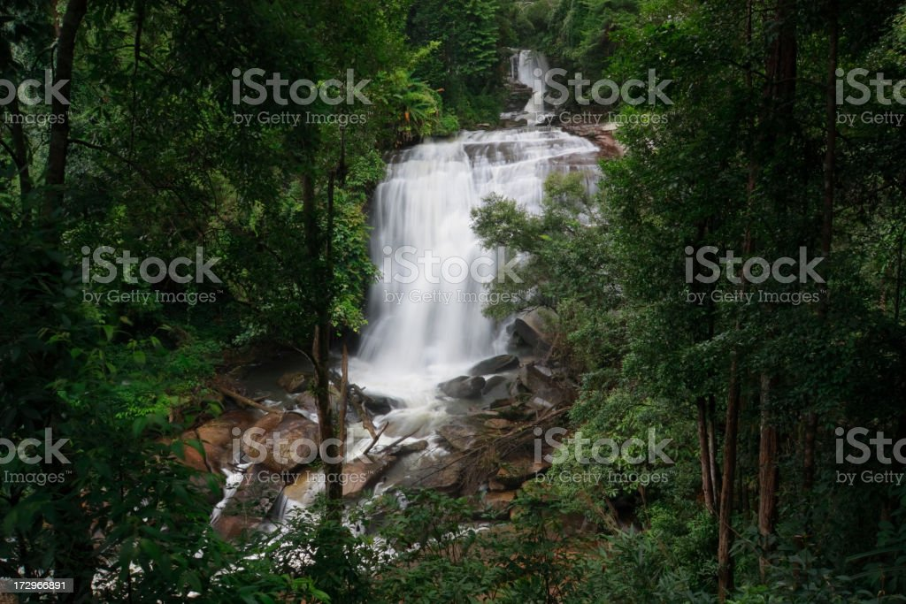 Sirithan waterfall in tropical forest stock photo