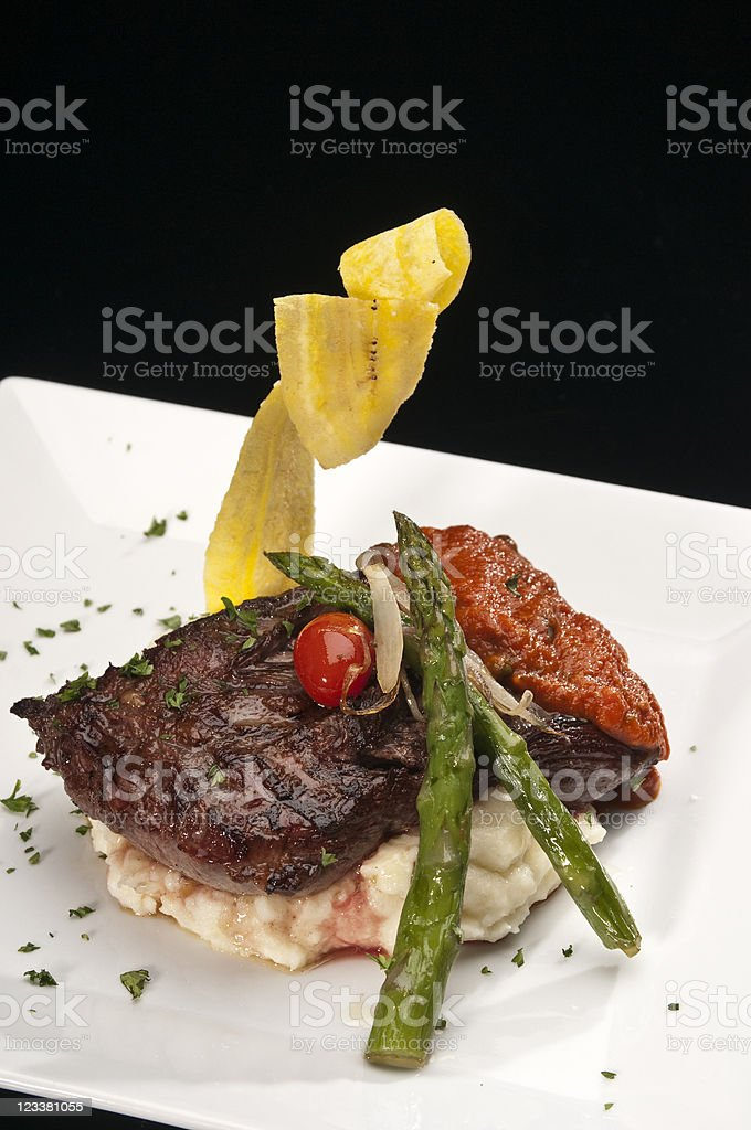 Sirloin steak with mashed potatoes and asparagus royalty-free stock photo
