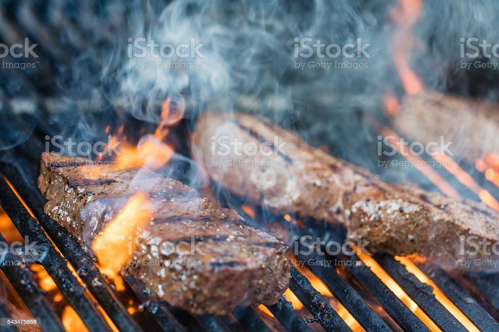 Sirloin steaks on the bbq stock photo