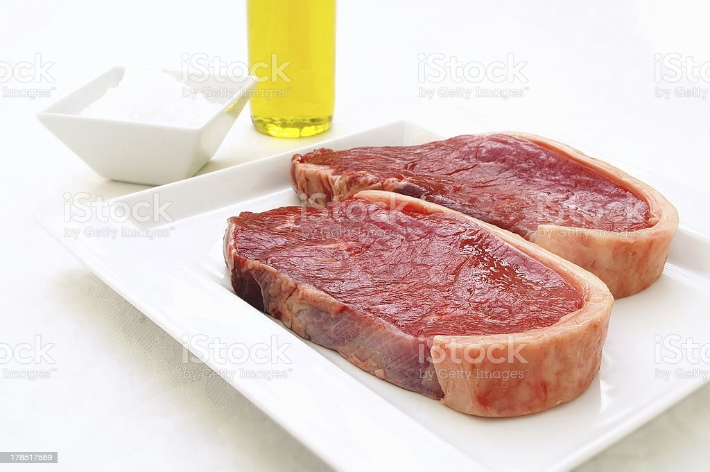 sirloin steaks on white plate royalty-free stock photo