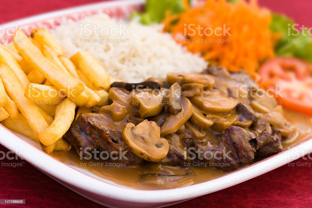 sirloin strip steak with french fries and rice royalty-free stock photo