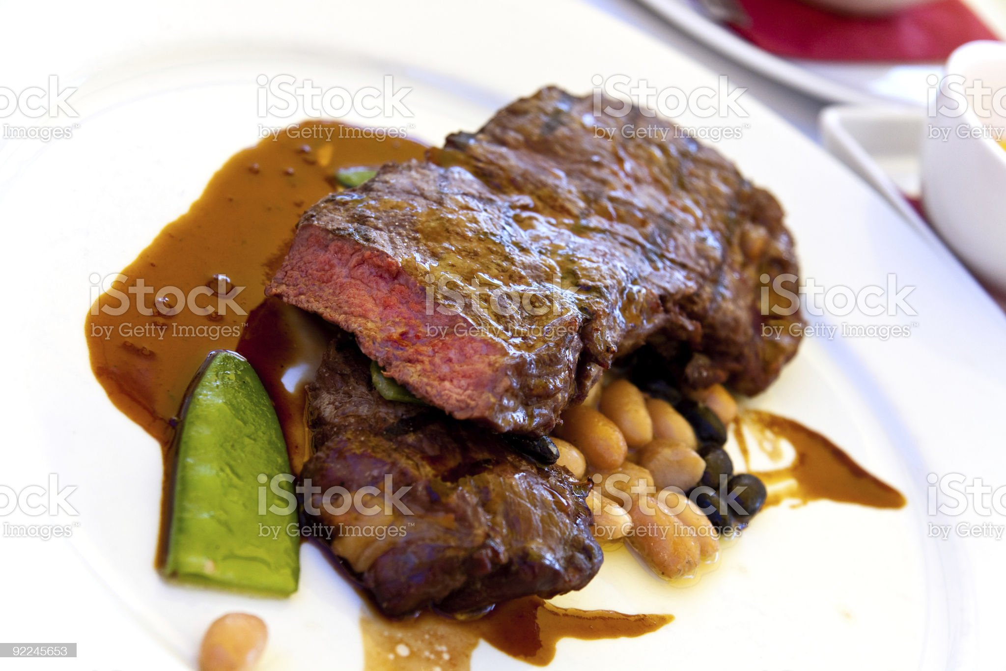 Sirloin strip Steak with green Beans ,vegetables and savory sauce royalty-free stock photo