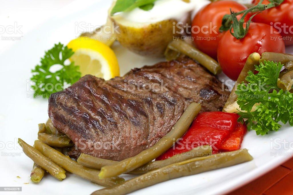 Sirloin Strip Steak with green beans,tomato,pepper royalty-free stock photo