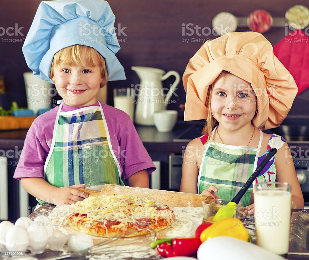 Sister and brother at the kitchen royalty-free stock photo