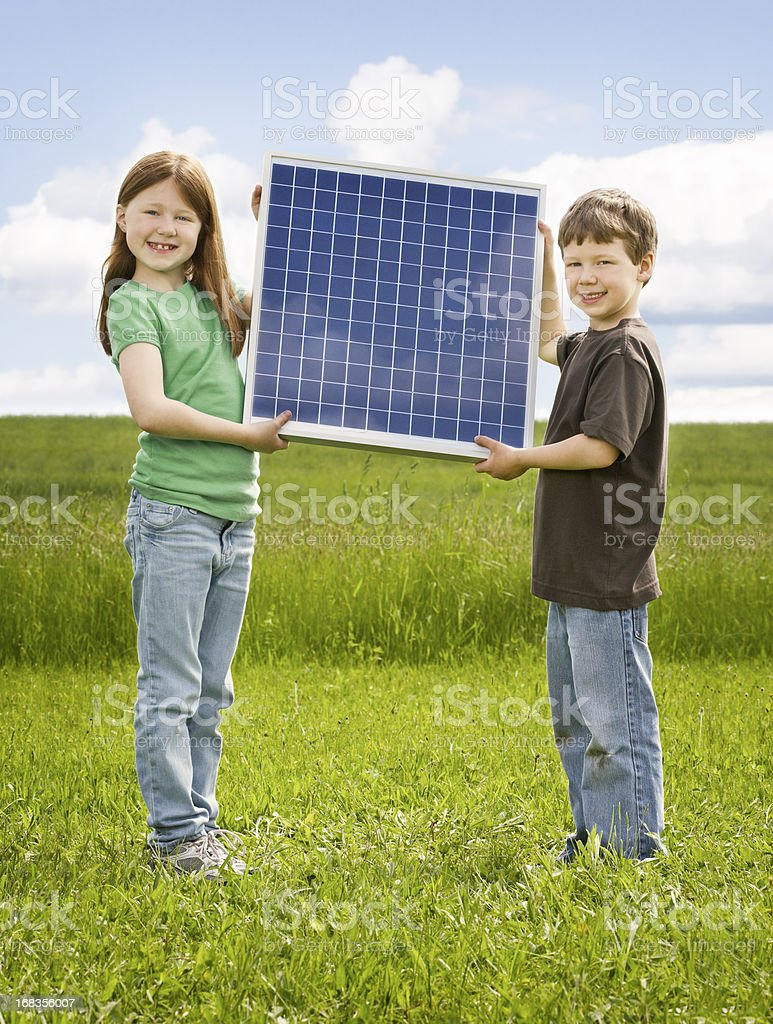 Sister and brother hold Solar Panel stock photo