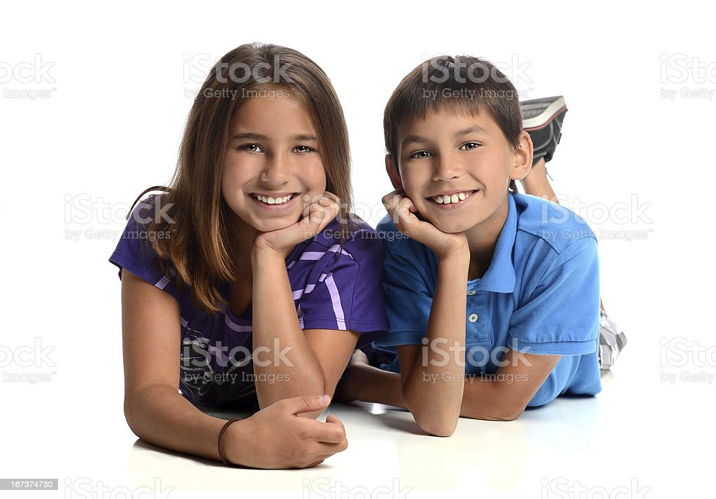 Sister and Brother Laying royalty-free stock photo