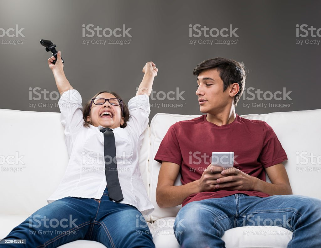 sister exulting and brothere embarassed stock photo