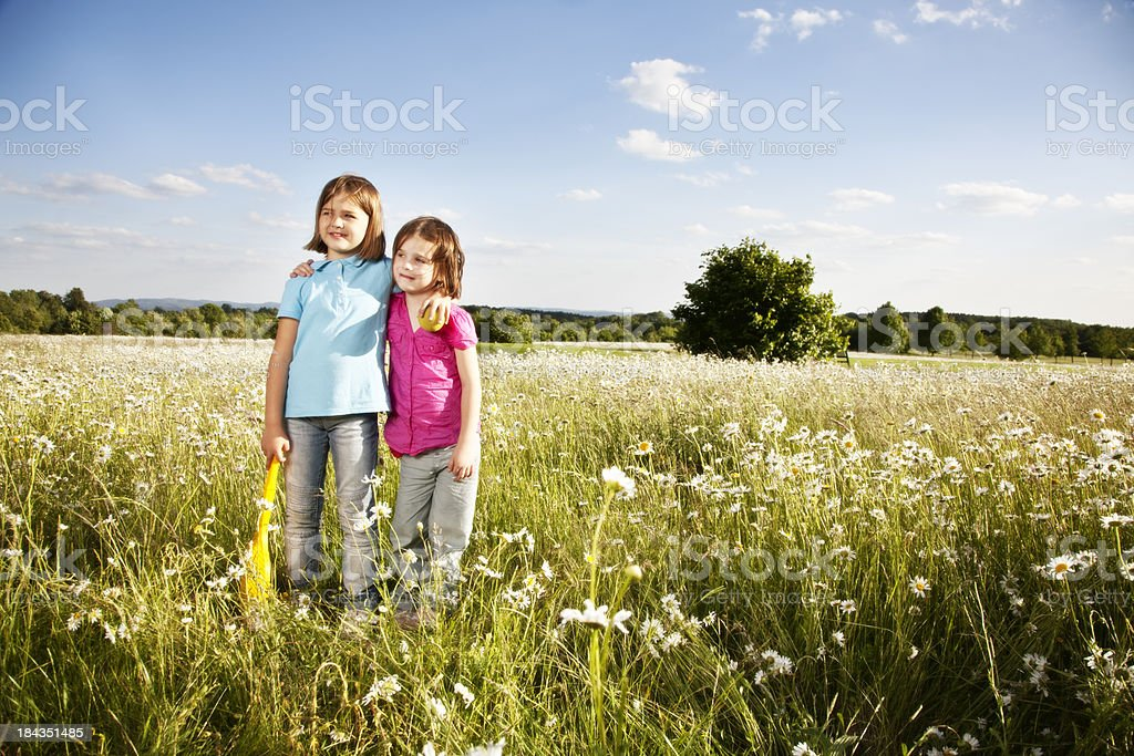 sister girls outdooors summer fun royalty-free stock photo