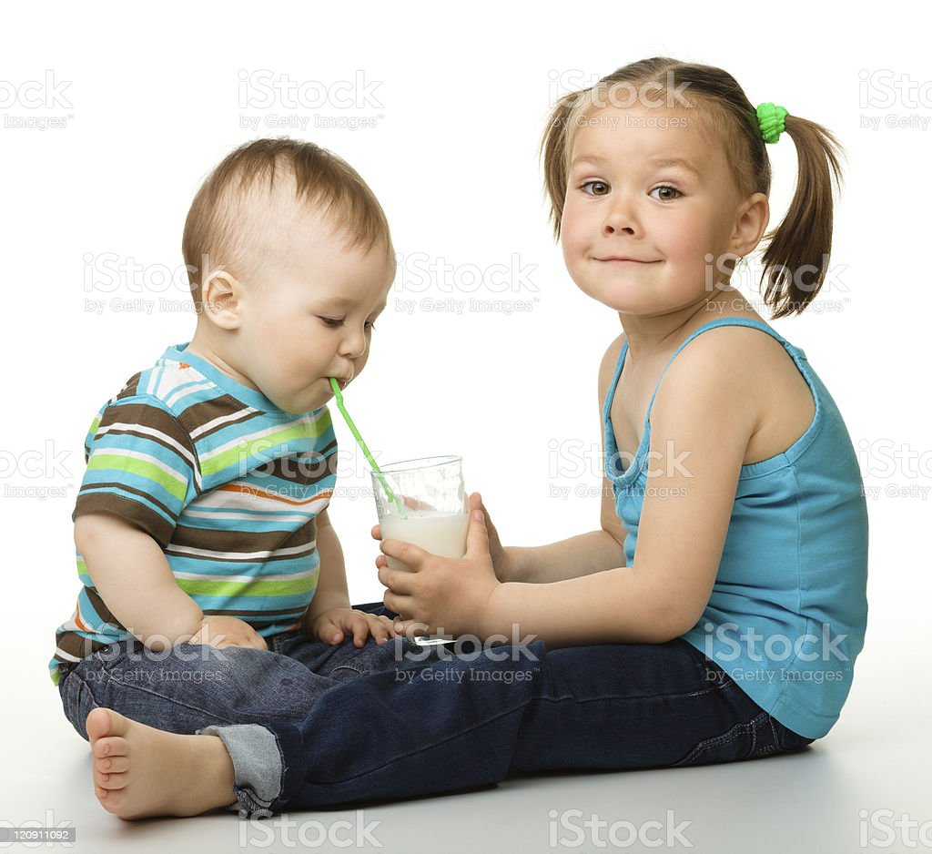 Sister is feeding her little brother royalty-free stock photo