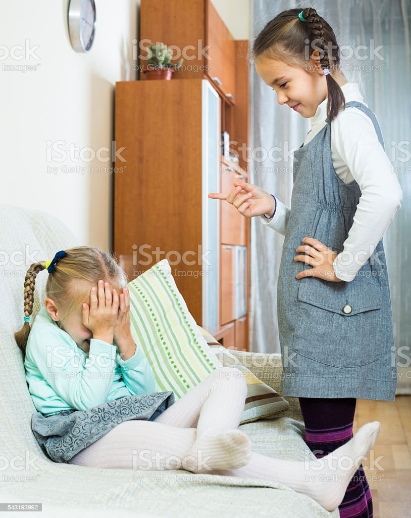 sister preaching little one stock photo