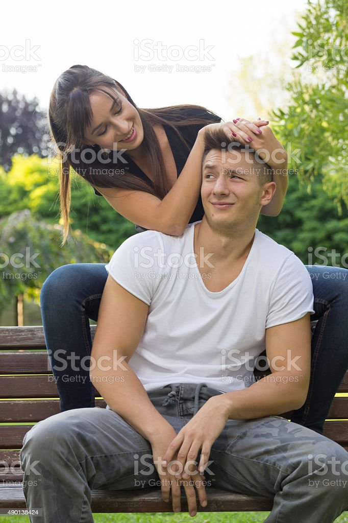 Sister teasing younger brother. stock photo