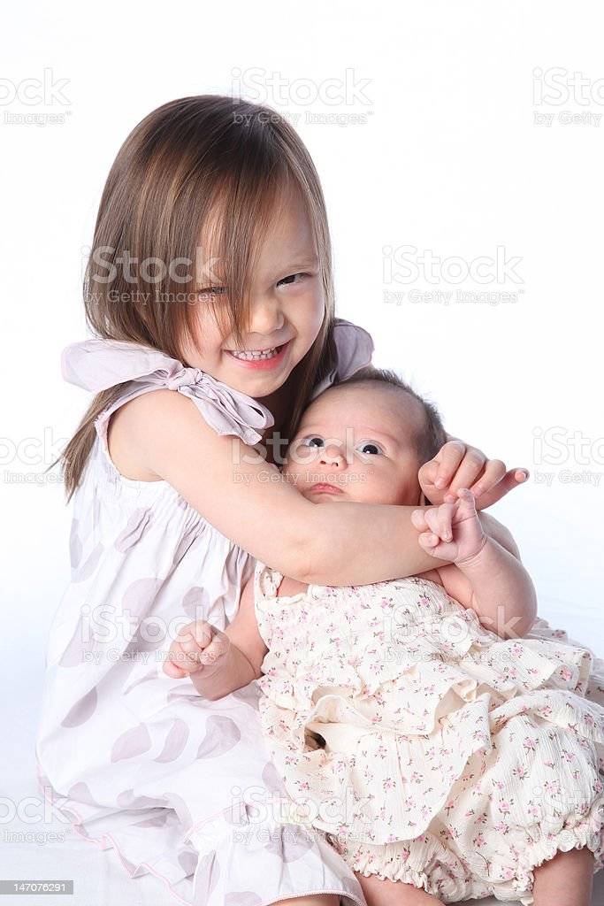 Sisterly love...Or is it? stock photo