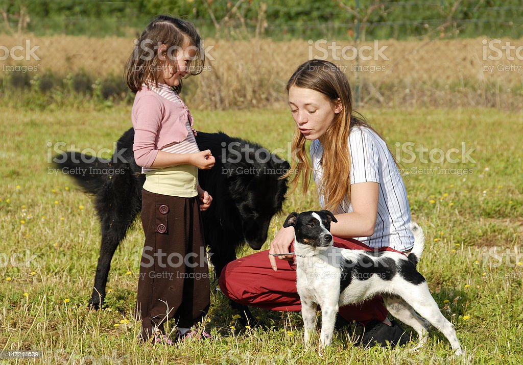 sisters and dogs royalty-free stock photo