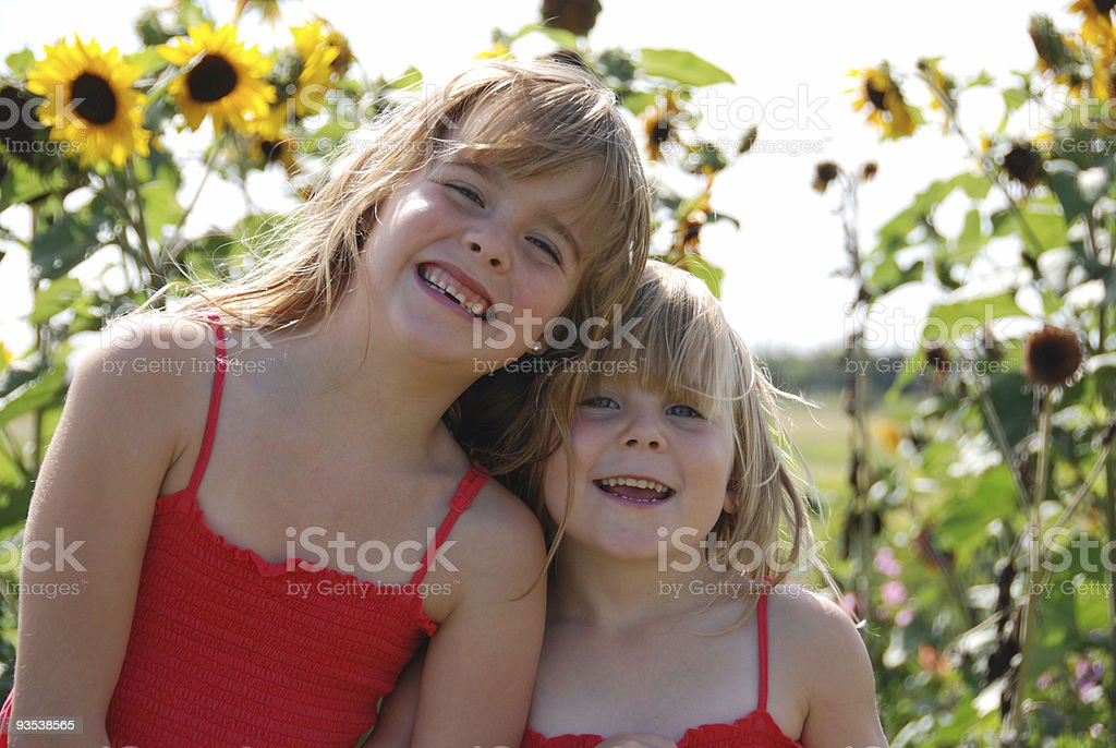 Sisters and Sunflowers royalty-free stock photo