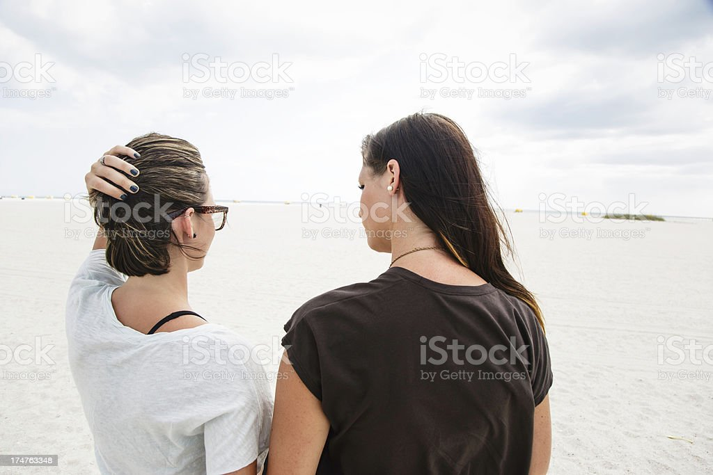 Sisters at beach wearing earrings royalty-free stock photo