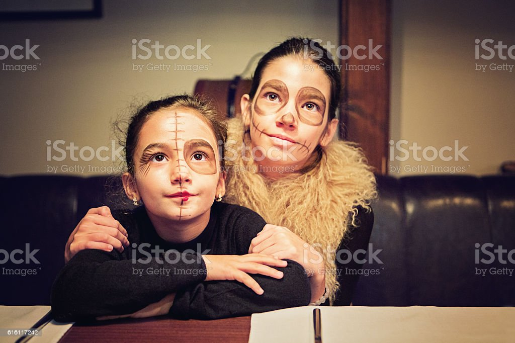 Sisters at Halloween stock photo
