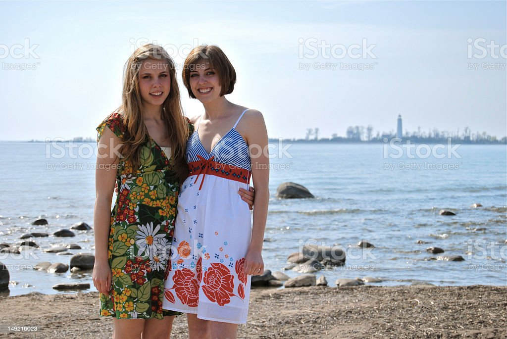 Sisters at the beach stock photo