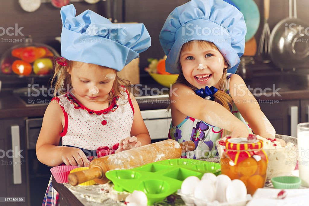 Sisters at the kitchen royalty-free stock photo