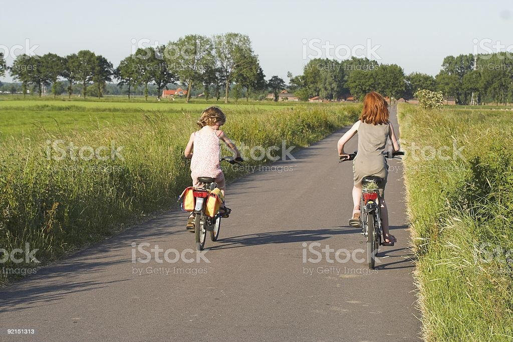 Sisters biking in Holland royalty-free stock photo
