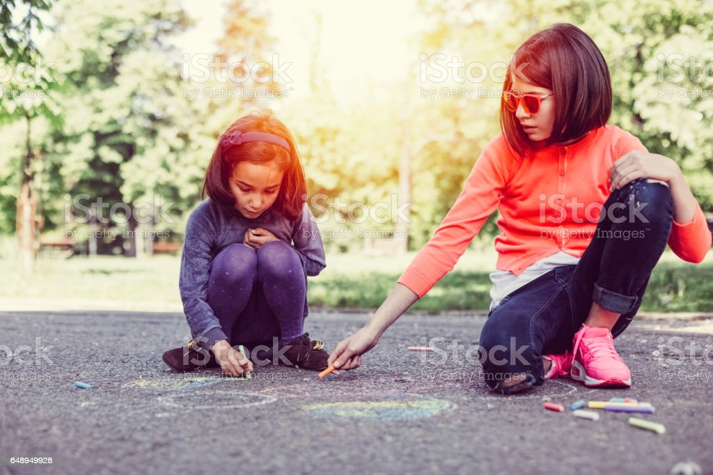 Sisters chalk drawing together stock photo