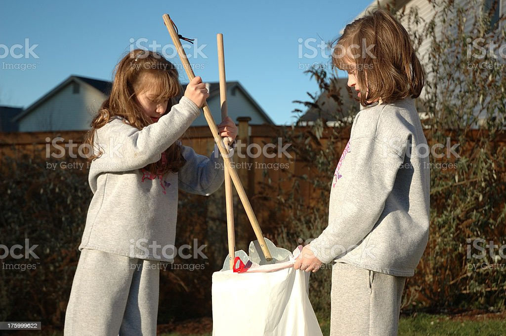 Sisters Doing Chores royalty-free stock photo