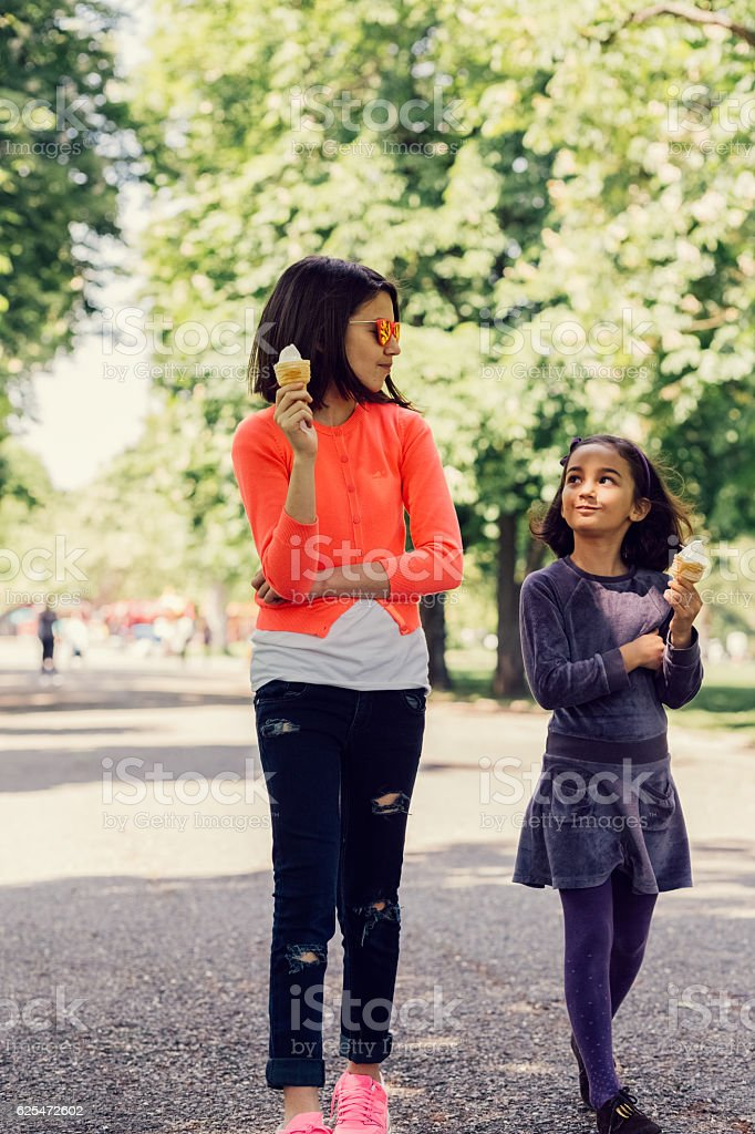 Sisters eating ice-cream together stock photo
