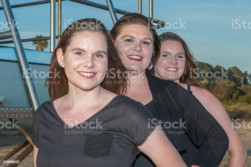 Sisters' faces lined up stock photo