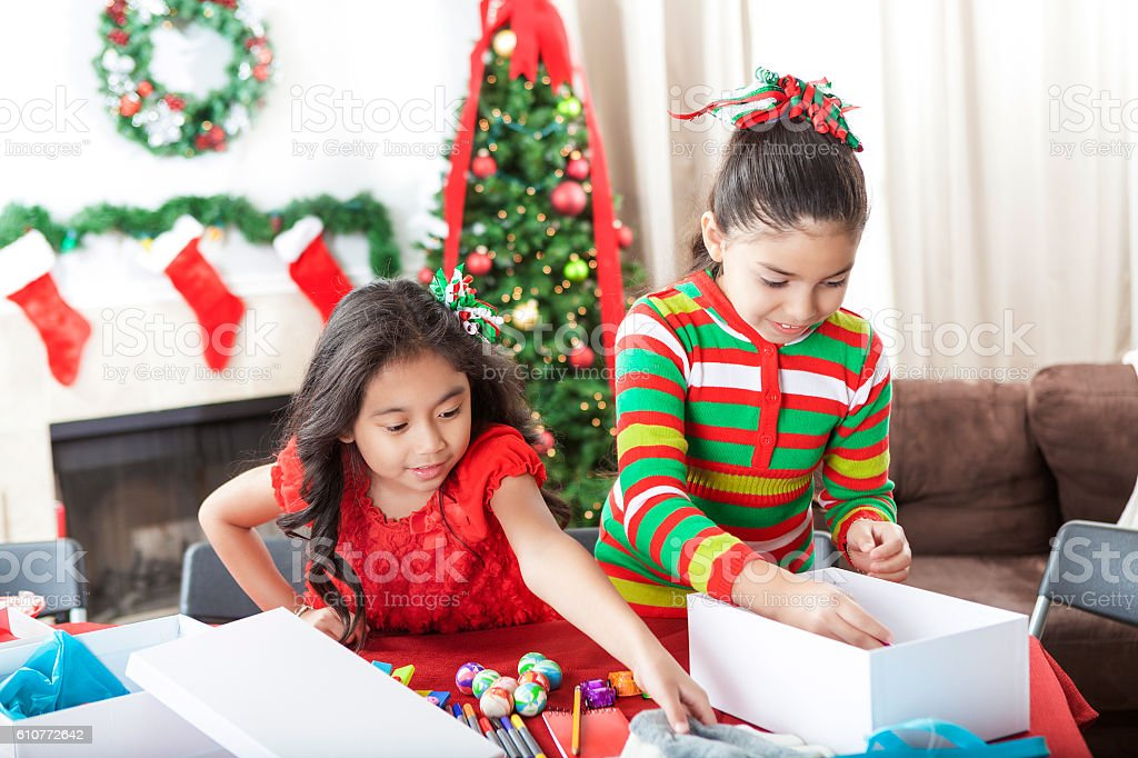 Sisters fill shoeboxes for charity at Christmastime stock photo