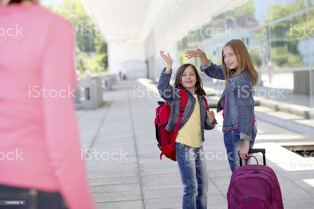 Sisters going back to class stock photo