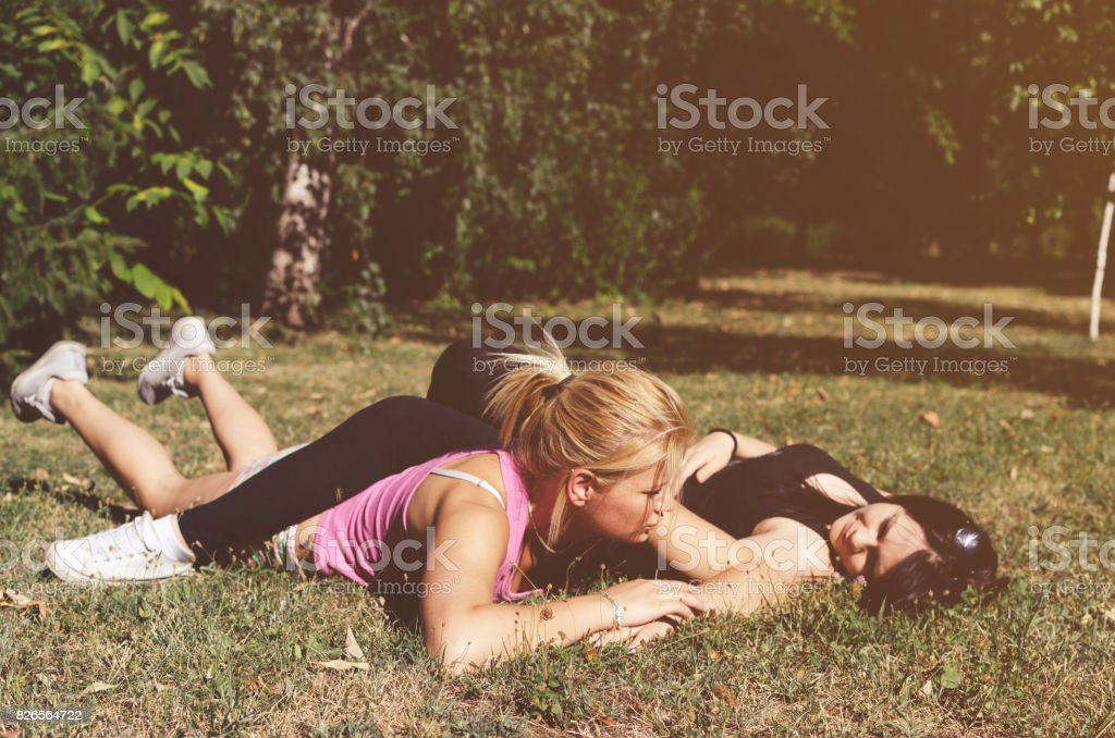 sisters having fun on the grass stock photo