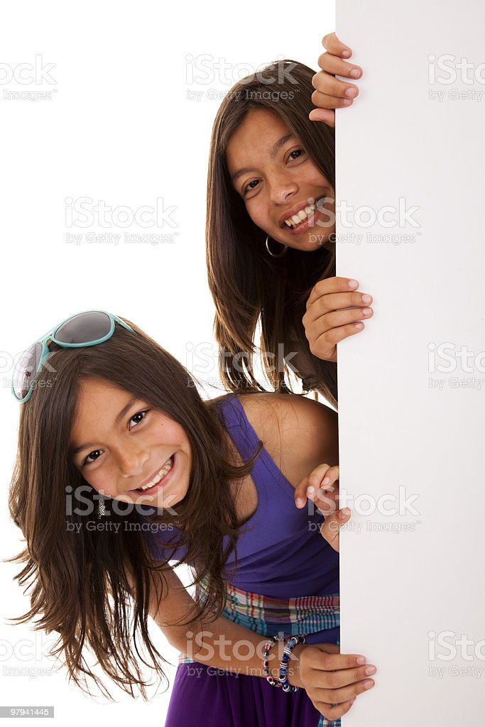 sisters holding a blank billboard stock photo