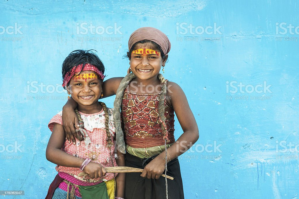 Sisters holding sticks royalty-free stock photo