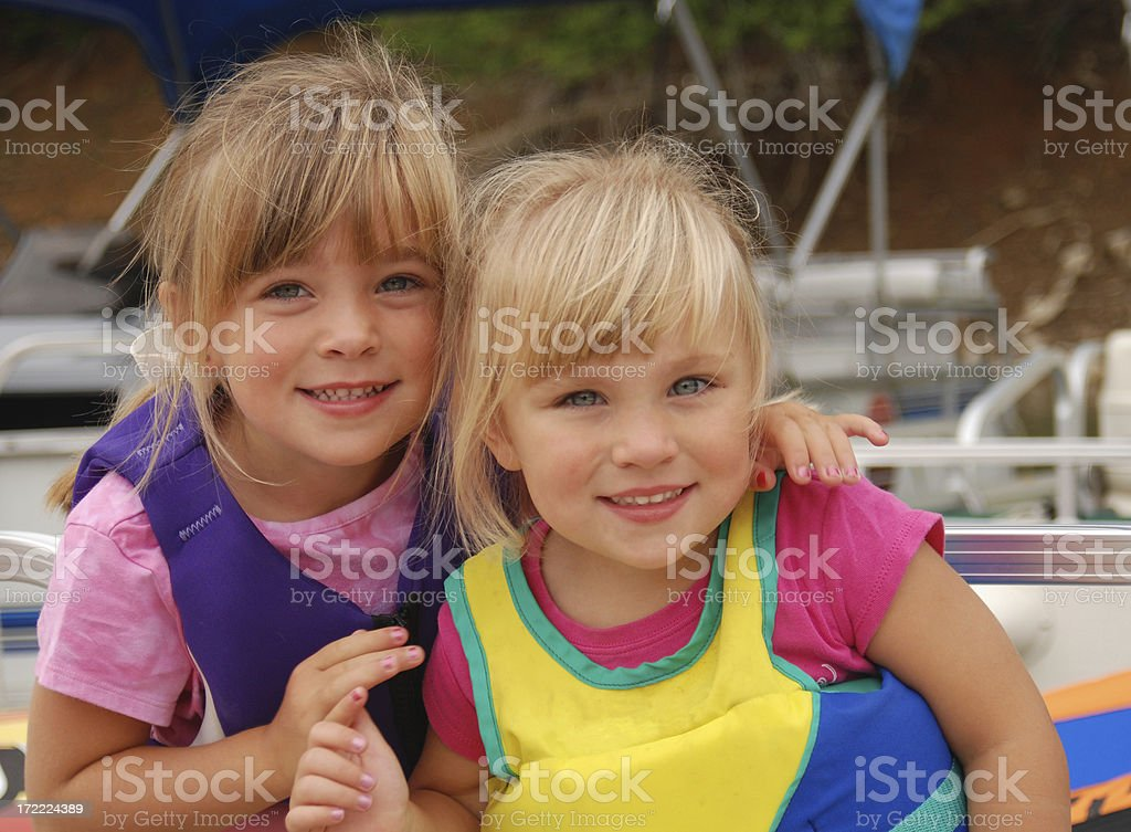 Sisters in a Boat royalty-free stock photo