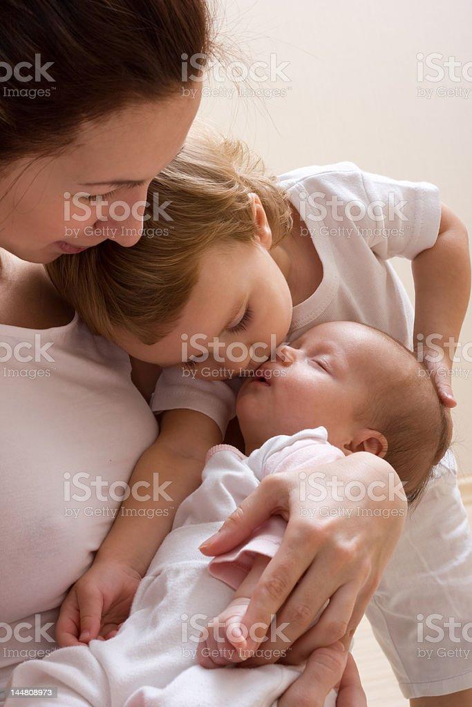 Sister's kiss royalty-free stock photo