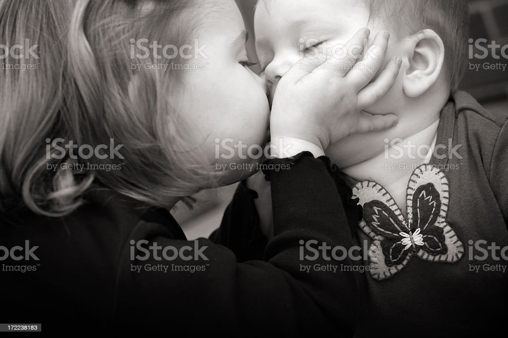 Sister's Kiss royalty-free stock photo