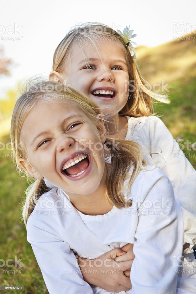 Sisters Laughing Together Outside royalty-free stock photo