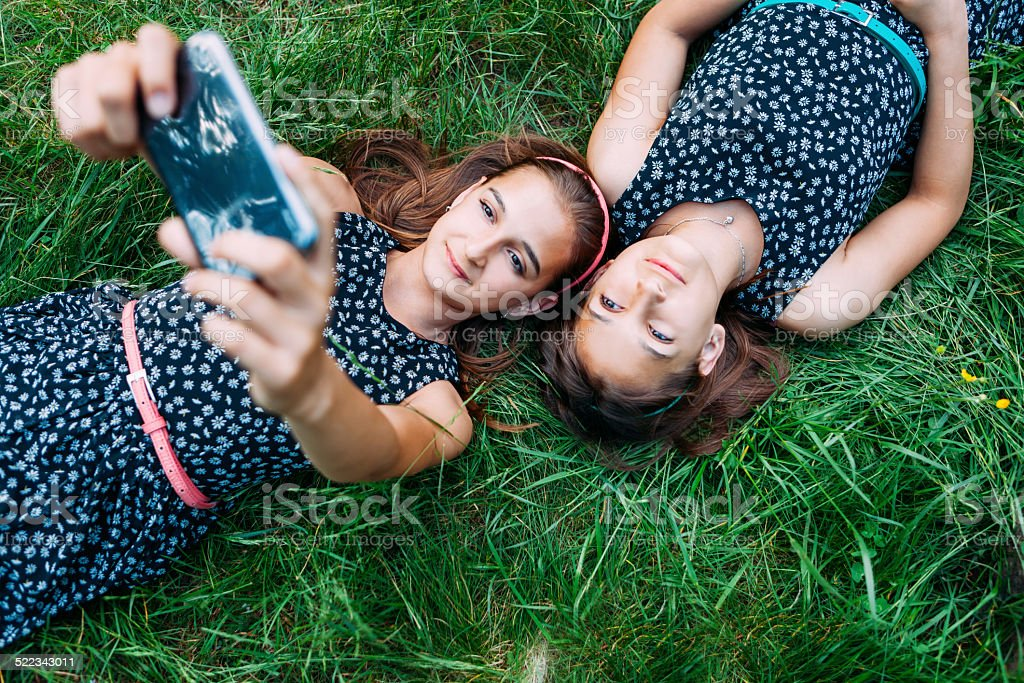 Sisters making a selfie stock photo