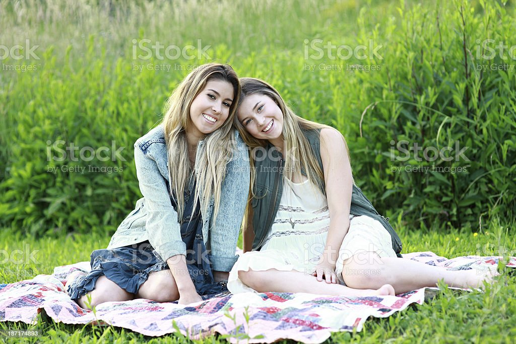 Sisters Outdoors on a Quilt royalty-free stock photo