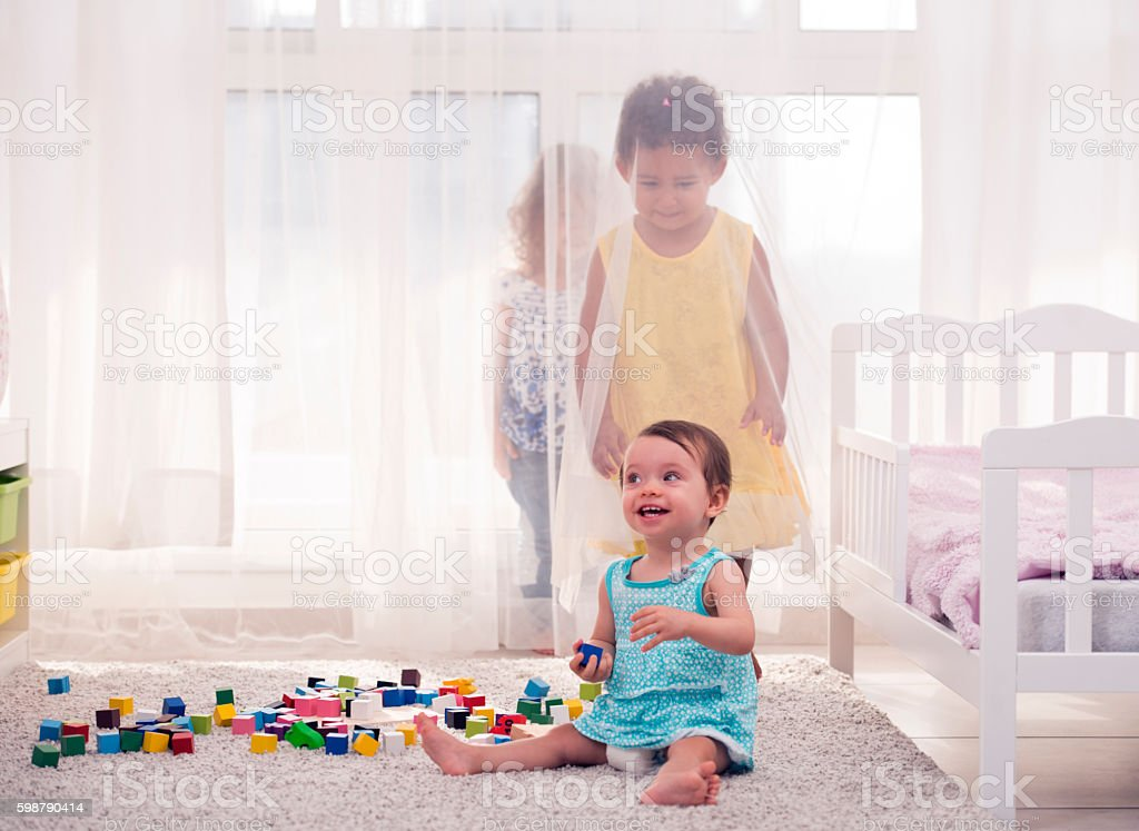 Sisters playing together. stock photo