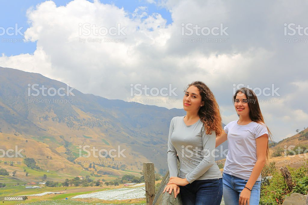 Sisters Posing on High Mountains stock photo
