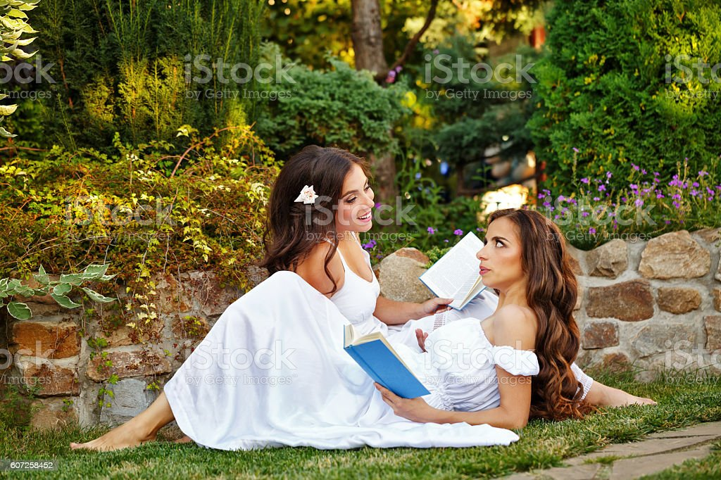 Sisters read books stock photo