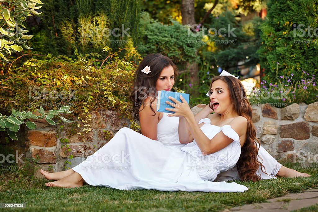 Sisters reading books stock photo