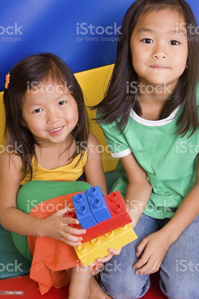 Sisters Sharing Blocks royalty-free stock photo